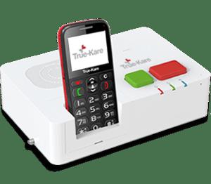 Telefone pousado num suporte branco com botões vermelho e verde